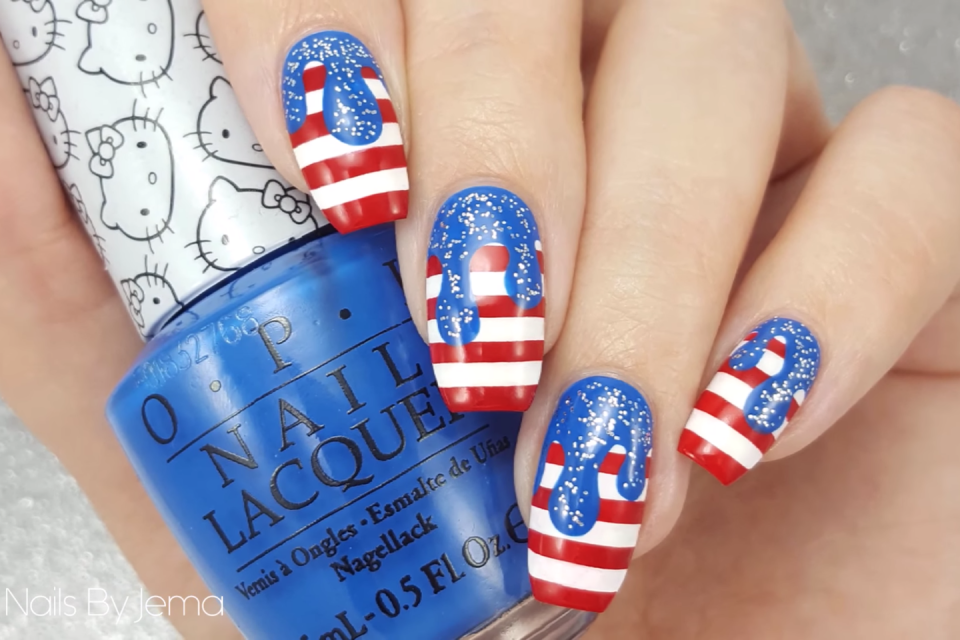 "<p>Like a melting popsicle on a hot summer day, this flag-inspired mani is the ultimate seasonal look. </p><p><a class=""link rapid-noclick-resp"" href=""https://www.amazon.com/JASSINS-Color-Striping-Decoration-Sticker/dp/B00HQA1FII/?tag=syn-yahoo-20&ascsubtag=%5Bartid%7C10055.g.1278%5Bsrc%7Cyahoo-us"" rel=""nofollow noopener"" target=""_blank"" data-ylk=""slk:SHOP NAIL ART TAPE"">SHOP NAIL ART TAPE</a></p><p><em><a href=""https://www.youtube.com/watch?v=qX_4R83QNzk"" rel=""nofollow noopener"" target=""_blank"" data-ylk=""slk:Get the tutorial on YouTube »"" class=""link rapid-noclick-resp"">Get the tutorial on YouTube »</a></em> </p>"