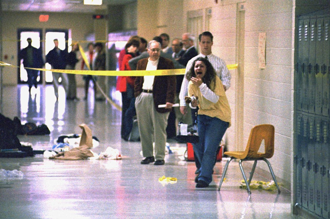 <p>The aftermath of the shooting, which left three students dead and five wounded. A 14 year-old freshman drew a handgun in a crowded school lobby and shot eight fellow students just finishing an informal prayer meeting. (Photo: Steve Nagy/The Paducah Sun/AP) </p>