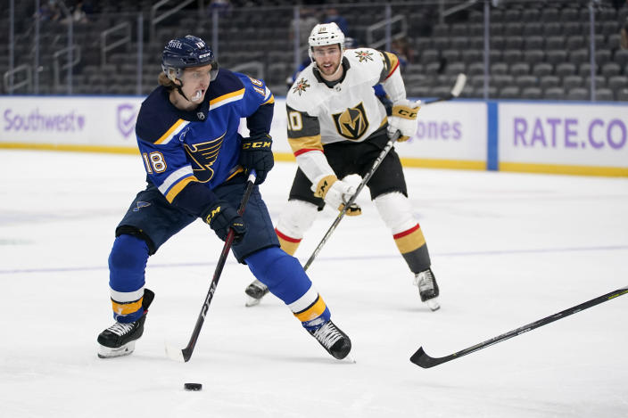 St. Louis Blues' Robert Thomas (18) looks for a shot as Vegas Golden Knights' Nicolas Roy (10) defends during the second period of an NHL hockey game Wednesday, April 7, 2021, in St. Louis. (AP Photo/Jeff Roberson)