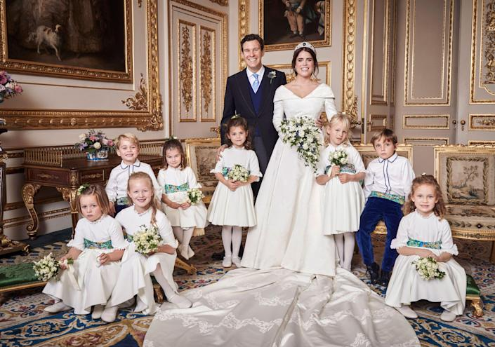 """<p>In <a href=""""https://www.townandcountrymag.com/society/tradition/g23760972/princess-eugenie-jack-brooksbank-prince-george-princess-charlotte-official-wedding-portraits/"""" rel=""""nofollow noopener"""" target=""""_blank"""" data-ylk=""""slk:an official portrait taken just"""" class=""""link rapid-noclick-resp"""">an official portrait taken just</a> after Eugenie's wedding, Prince George gives a big smile while seated with the rest of the page boys and bridesmaids. </p>"""