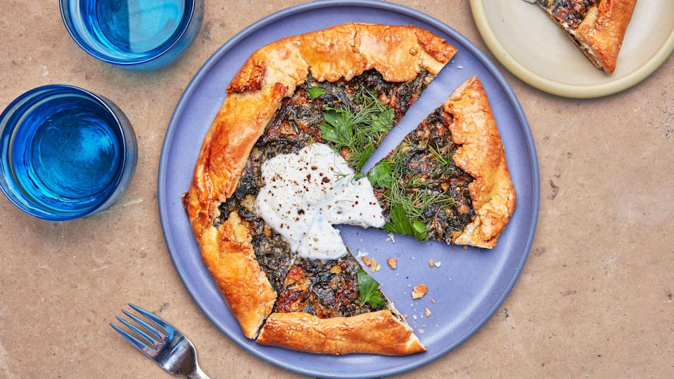 "While butter is the usual choice for galette or pie dough, a combination of olive oil and yogurt gives this crust a flaky texture and a golden brown color when baked. If the dough is a little crumbly when rolling it out, don't worry: Just patch it back up. <a href=""https://www.bonappetit.com/recipe/butter-free-flaky-galette-with-spicy-greens?mbid=synd_yahoo_rss"" rel=""nofollow noopener"" target=""_blank"" data-ylk=""slk:See recipe."" class=""link rapid-noclick-resp"">See recipe.</a>"