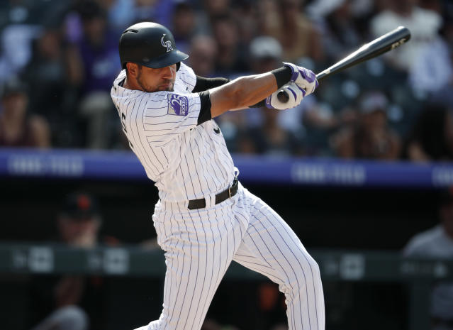 Colorado Rockies pinch-hitter Noel Cuevas follows through with his swing after connecting for a single to drive in the tying and go-ahead runs off San Francisco Giants relief pitcher Tony Watson in the eighth inning of a baseball game Monday, Sept. 3, 2018, in Denver. (AP Photo/David Zalubowski)