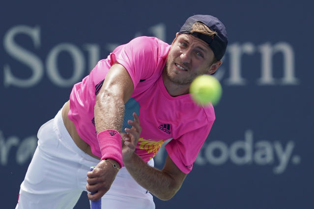 Lucas Pouille, of France, serves to Andy Murray, of Great Britain, in the first round at the Western & Southern Open, Monday, Aug. 13, 2018, in Mason, Ohio. (AP Photo/John Minchillo)