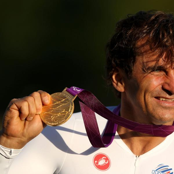 LONGFIELD, ENGLAND - SEPTEMBER 05: Alessandro Zanardi of Italy celebrates with his Gold medal after winning the Men's Individual H4 Time Trialon day 7 of the London 2012 Paralympic Games at Brands Hatch on September 5, 2012 in Longfield, England. (Photo by Clive Rose/Getty Images)