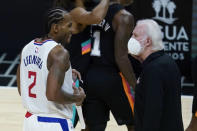 Los Angeles Clippers forward Kawhi Leonard (2) talks to San Antonio Spurs coach Gregg Popovich during a timeout in the third quarter of an NBA basketball game Tuesday, Jan. 5, 2021, in Los Angeles. (AP Photo/Ashley Landis)