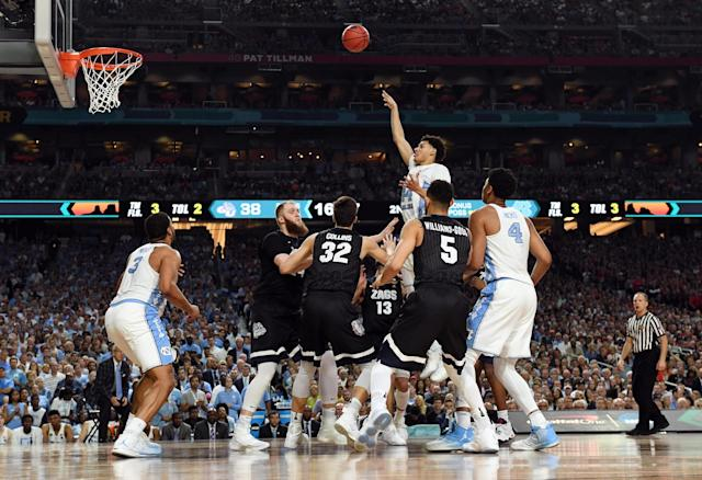 <p>North Carolina Tar Heels forward Justin Jackson (44) shoots the ball against Gonzaga Bulldogs forward Zach Collins (32) during the second half in the championship game of the 2017 NCAA Men's Final Four at University of Phoenix Stadium. Mandatory Credit: Robert Deutsch-USA TODAY Sports </p>
