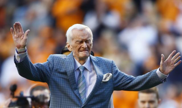 FILE - In this Nov. 25, 2017 file photo former voice of the Tennessee Vols, John Ward, is recognized during a timeout in an NCAA college football game between Tennessee and Vanderbilt in Knoxville, Tenn. Ward, who served as the radio voice of Tennessee football and mens basketball for over three decades, has died. He was 88. Vol Network tweeted that Ward died Wednesday, June 20, 2018 in Knoxville. (AP Photo/Wade Payne, file)