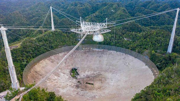 PHOTO: This aerial view shows a hole in the dish panels of the Arecibo Observatory in Arecibo, Puerto Rico, on Nov. 19, 2020. (Ricardo Arduengo/AFP via Getty Images)