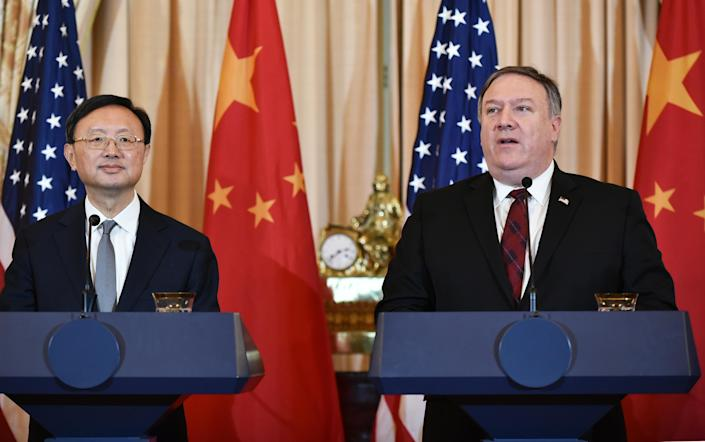 US Secretary of State Mike Pompeo (R) speaks during a press conference with Chinese politburo member Yang Jiechi during the US-China Diplomatic and Security Dialogue in the Benjamin Franklin Room of the State Department in Washington, DC on November 9, 2018. (Photo by MANDEL NGAN / AFP) (Photo credit should read MANDEL NGAN/AFP via Getty Images)