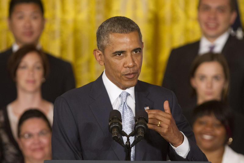 Prodding Congress, Obama acts to ease student debt