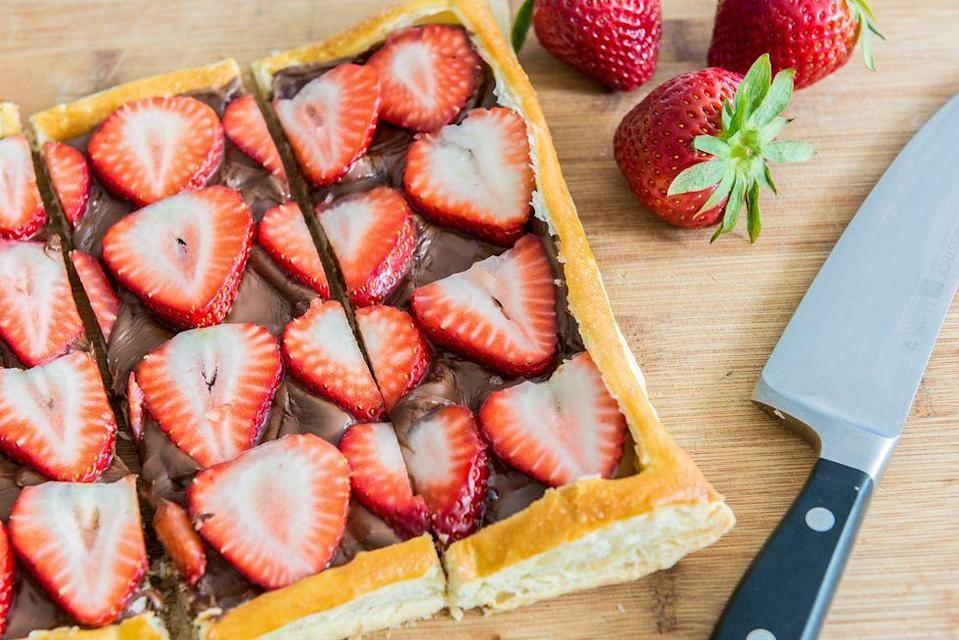 """<p>This recipe feels fancy, but is actually pretty simple in execution. Plus, it gives you a good excuse to eat Nutella by the spoonful. </p><p><em>Get the recipe from <a href=""""https://www.thepioneerwoman.com/food-cooking/recipes/a92432/strawberry-nutella-puff-pastry/"""" rel=""""nofollow noopener"""" target=""""_blank"""" data-ylk=""""slk:The Pioneer Woman"""" class=""""link rapid-noclick-resp"""">The Pioneer Woman</a>.</em></p>"""