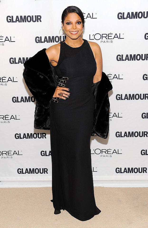 """Janet Jackson, who was on hand to present an award to her friend Donatella, was luminous in a black Atelier Versace (natch!) gown paired with a faux fur jacket and gold jewels. Dimitrios Kambouris/<a href=""""http://www.wireimage.com"""" target=""""new"""">WireImage.com</a> - November 8, 2010"""