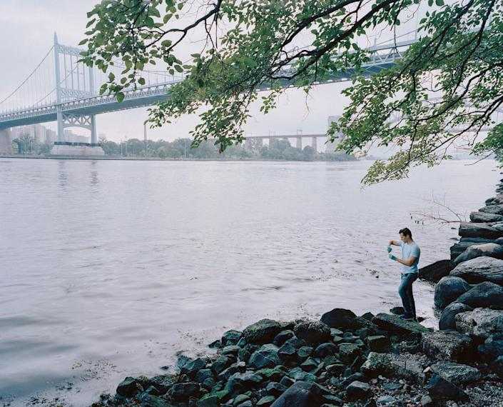 """<p>Citizen Science Leader (CSL), Peter Tavolacci, tests East River water quality on the banks of Astoria Park in Queens, New York City. Peter is a HSBC employee and was trained as a CSL by Earthwatch as part of the HSBC Water Program. He joined the FreshWater Watch community of more than 8,000 people who have collected 15,000 water quality samples around the world. Peter said, """"I've always felt a real connection with nature. I remember my days in the Scouts where we would always strive to leave nature even better than how we found it, so joining this program was natural for me. I have absolute belief that my collection of data can have a big impact because of the number of people around the world joining in."""" (Photograph by Mustafah Abdulaziz/Earthwatch) </p>"""