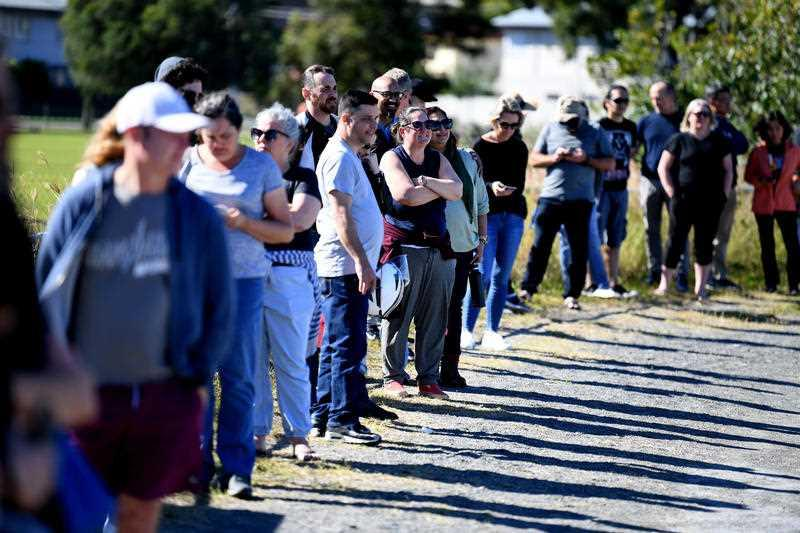 People line up to receive a coronavirus vaccination at the Rocklea Showgrounds in Brisbane.