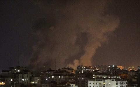 Smoke rises after Israeli army conducted air strikes towards different regions of Gaza City - Credit: Getty