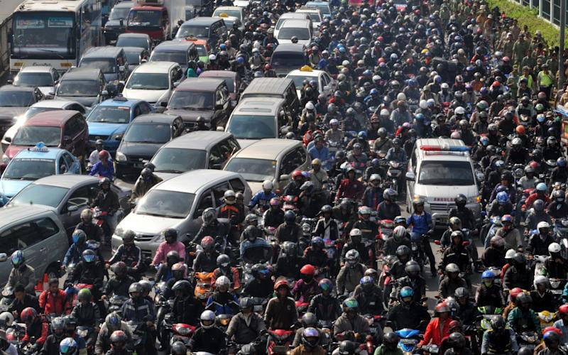 The number of motor vehicles including motorcycles in greater Jakarta has almost tripled in the past eight years to 9.52 million - Credit: AFP