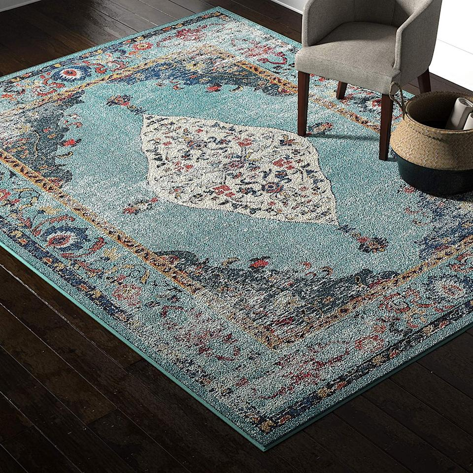 """<p>Instantly brighten up any room with this <a href=""""https://www.popsugar.com/buy/Rivet-Distressed-Color-Medallion-Rug-502903?p_name=Rivet%20Distressed%20Color%20Medallion%20Rug&retailer=amazon.com&pid=502903&price=59&evar1=casa%3Aus&evar9=45996353&evar98=https%3A%2F%2Fwww.popsugar.com%2Fhome%2Fphoto-gallery%2F45996353%2Fimage%2F46773025%2FRivet-Distressed-Color-Medallion-Rug&list1=shopping%2Camazon%2Chome%20decor%2Crugs%2Chome%20shopping&prop13=api&pdata=1"""" rel=""""nofollow"""" data-shoppable-link=""""1"""" target=""""_blank"""" class=""""ga-track"""" data-ga-category=""""Related"""" data-ga-label=""""https://www.amazon.com/Rivet-Distressed-Color-Medallion-Aqua/dp/B073F92XNV/ref=sr_1_9?keywords=rivet%2Barea%2Brug&amp;qid=1571261121&amp;sr=8-9&amp;th=1"""" data-ga-action=""""In-Line Links"""">Rivet Distressed Color Medallion Rug</a> ($59-$280).</p>"""