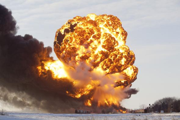 Mandatory Credit: Photo by ZUMA/REX (3452782b) A massive fireball from an exploding train car rises into the air just west of Casselton. Train collision ignites an oil tankers in North Dakota, America - 30 Dec 2013 The freight train was carrying 110 cars and went off the tracks west of Casselton and was hit by a second train. There were no reports of injuries from the accident.