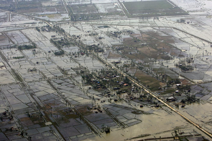 FILE - This May 6, 2008 file photo, shows an aerial view of devastation caused by Cyclone Nargis, seen at an unknown location in Myanmar. Freaky storms like 2013's Typhoon Haiyan, 2012's Superstorm Sandy and 2008's ultra-deadly Cyclone Nargis may not have been caused by warming, but their fatal storm surges were augmented by climate change's ever rising seas, Maarten van Aalst, a top official at the International Federation of Red Cross and Red Crescent Societies said. Global warming is driving humanity toward a whole new level of many risks, a United Nations scientific panel reports, warning that the wild climate ride has only just begun. (AP Photo/File)