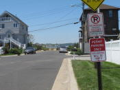 A sign is displayed on a side street in Sea Bright N.J. on May 15, 2021, restricting parking to those with a permit. Some shore towns in New Jersey and other states have used parking restrictions as a way to keep outsiders off their beaches. Sea Bright does offer a public parking lot near one beach. (AP Photo/Wayne Parry)