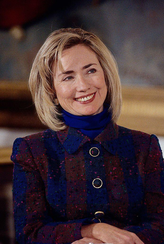 "<p>Here at <em>Marie Claire</em>, we know how <a href=""https://www.marieclaire.com/fashion/a31275353/hillary-clinton-fashion-legacy/"" rel=""nofollow noopener"" target=""_blank"" data-ylk=""slk:influential Hillary"" class=""link rapid-noclick-resp"">influential Hillary</a> is when it comes to first lady fashion. I mean, the pantsuit was practically invented by her, but for history's sake, we're highlighting this iconic gem: a deep blue turtleneck with a matching plaid jacket. </p>"
