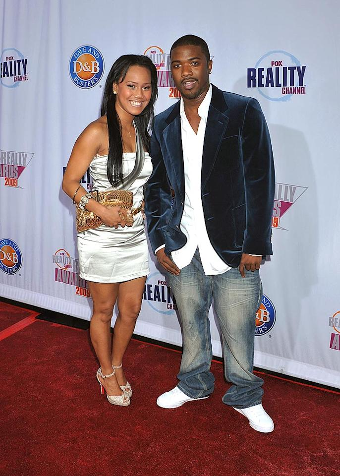 """Ray J was escorted by a mystery woman. Since he's taping a second season of """"For the Love of Ray J,"""" we're guessing she's not his main squeeze! Jeffrey Mayer/<a href=""""http://www.wireimage.com"""" target=""""new"""">WireImage.com</a> - October 13, 2009"""