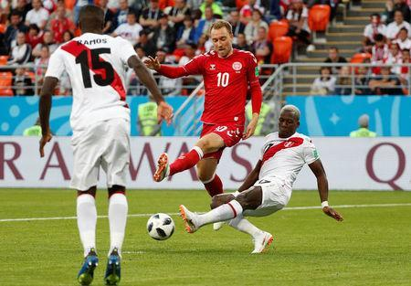 Soccer Football - World Cup - Group C - Peru vs Denmark - Mordovia Arena, Saransk, Russia - June 16, 2018 Denmark's Christian Eriksen in action with Peru's Luis Advincula REUTERS/Max Rossi