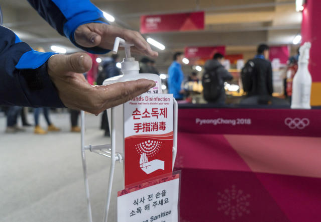 A man sanitizes his hands at the entrance to the media cafeteria in Gangneung, South Korea, Wednesday, Feb. 7, 2018. South Korean authorities deployed 900 military personnel at the PyeongChang Olympics on Tuesday after the security force was depleted by an outbreak of norovirus. (AP)