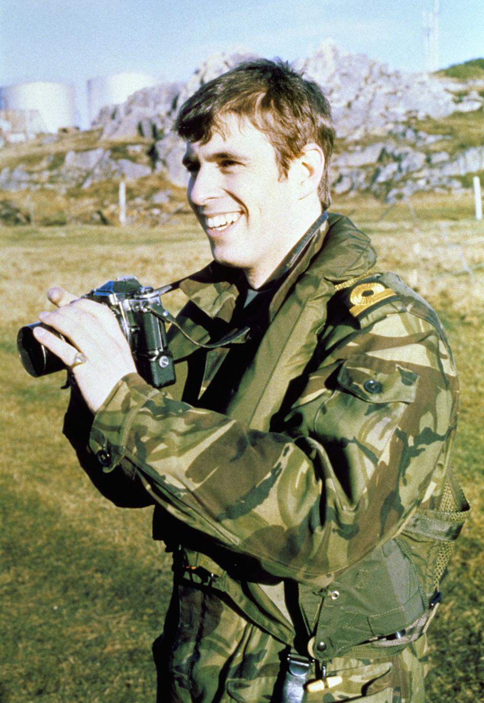 Prince Andrew (later the Duke of York) in the Falklands with a camera.   (Photo by PA Images via Getty Images)