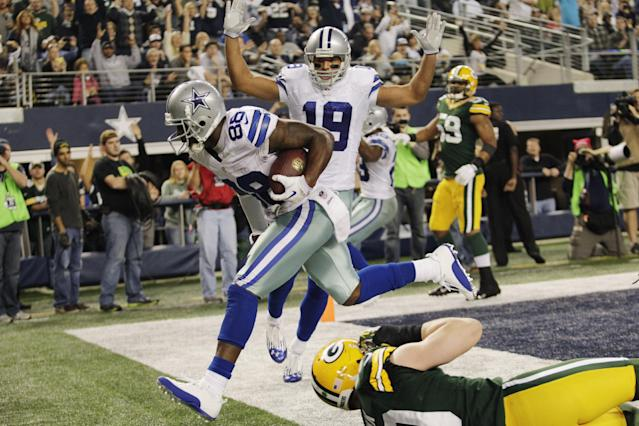 Dallas Cowboys wide receiver Dez Bryant (88) pulls in a touchdown pass over Green Bay Packers inside linebacker A.J. Hawk (50) as Cowboys' wide receiver Miles Austin (19) looks on during the second half of an NFL football game, Sunday, Dec. 15, 2013, in Arlington, Texas. (AP Photo/Tim Sharp)
