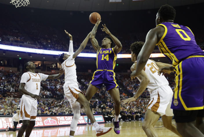 LSU guard Marlon Taylor (14) is fouled by Texas guard Donovan Williams (4) as he tries to score during the first half of an NCAA college basketball game, Saturday, Jan. 25, 2020, in Austin, Texas. (AP Photo/Eric Gay)