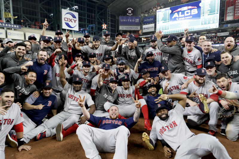 The Boston Red Sox pose for a picture after winning the baseball American League Championship Series against the Houston Astros on Thursday, Oct. 18, 2018, in Houston. Red Sox won 4-1. (AP Photo/David J. Phillip)
