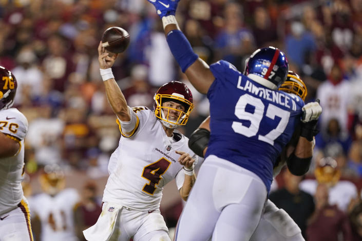 Washington Football Team quarterback Taylor Heinicke (4) throws a touchdown pass to wide receiver Terry McLaurin against the New York Giants during the first half of an NFL football game, Thursday, Sept. 16, 2021, in Landover, Md. (AP Photo/Alex Brandon)