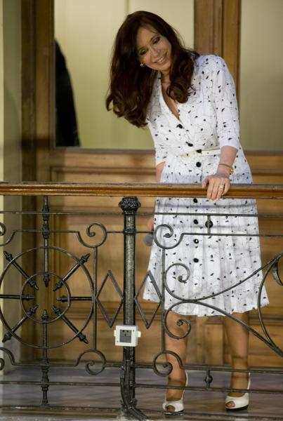 Argentina's President Cristina Fernandez smiles at supporters after a ceremony at the government house in Buenos Aires, Argentina, Wednesday, Jan. 22, 2014. Fernandez spoke in public for the first time Wednesday since Dec. 10. Her 42-day silence had been feeding speculation in Argentina about her health in the wake of the head surgery she underwent in October. Some opponents have questioned who is running the country. (AP Photo/Natacha Pisarenko)
