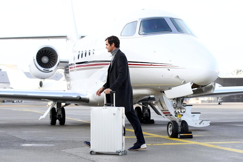 GENEVA, SWITZERLAND - FEBRUARY 08: Roger Federer of Switzerland walks past the Netjets plane as he arrives ahead of the The Laver Cup Press Conference on February 08, 2019 in Geneva, Switzerland. (Photo by Julian Finney/Getty Images for The Laver Cup)
