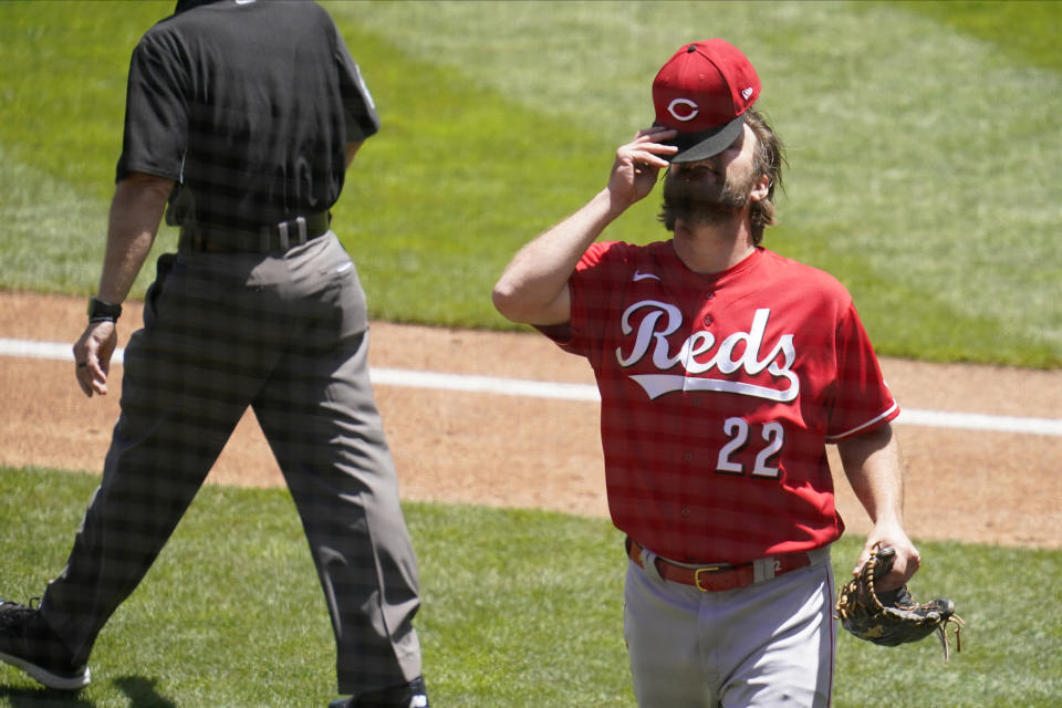 Cincinnati Reds pitcher Wade Miley puts his cap back on following an inspection for any illegal substance by umpires after the third inning of a baseball game against the Minnesota Twins, Tuesday, June 22, 2021, in Minneapolis. (AP Photo/Jim Mone)
