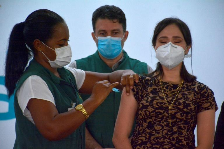 A healthcare worker receives an injection of the CoronaVac vaccine on January 19, 2021 in Manaus, Brazil