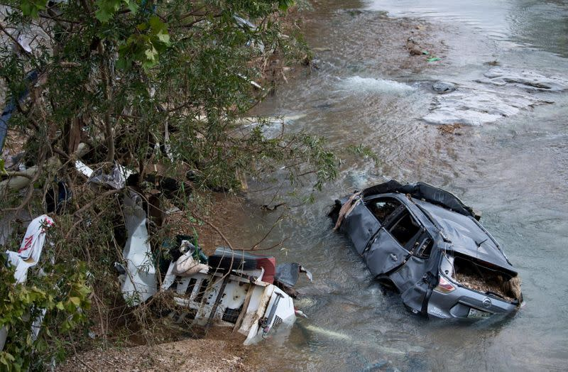 A flooded car and debris are seen in Trace Creek, Waverly, Tennessee