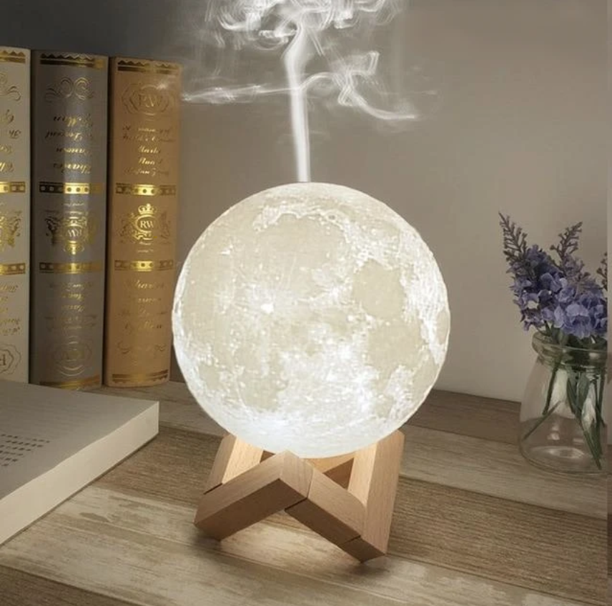 "<p><strong>Wooden Goods </strong></p><p>Wooden Goods </p><p><strong>$40.00</strong></p><p><a href=""https://woodengoods.co/products/880ml-ultrasonic-moon-essential-oil-diffuser?variant=29149537632361&gclid=EAIaIQobChMI8JS-_ZDi6wIV9cuGCh2ZYQRtEAQYEiABEgIpmfD_BwE"" rel=""nofollow noopener"" target=""_blank"" data-ylk=""slk:shop now"" class=""link rapid-noclick-resp"">shop now</a></p><p>If someone says they love you to the moon and back, send them this link. Besides looking this incredible, it also has three light settings you can change by touch. Choose between three stands to support this diffuser.</p>"