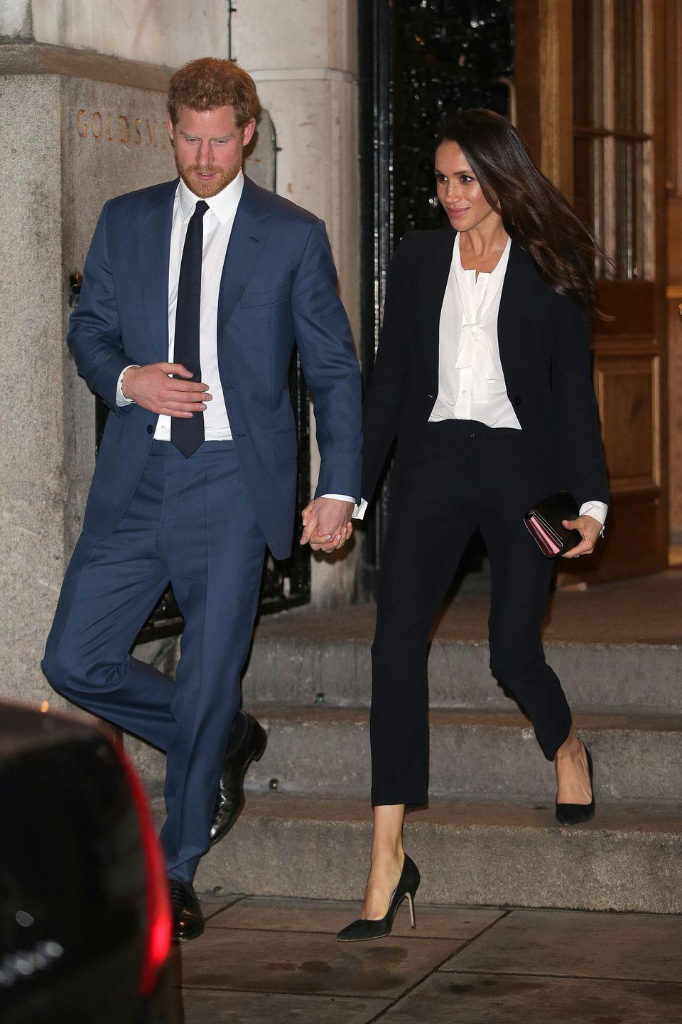 """<p>Meghan looked super fashion-forward (like she always does, TBH) when she stepped out in this Alexander McQueen suit in February 2018. But perhaps more notable than her chic pantsuit was the fact that her white blouse was actually a BODYSUIT (!!!) <a href=""""https://www.tuxebodywear.com/"""" rel=""""nofollow noopener"""" target=""""_blank"""" data-ylk=""""slk:by the brand Tuxe"""" class=""""link rapid-noclick-resp"""">by the brand Tuxe</a>. </p>"""