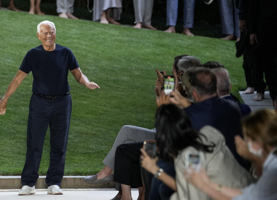 Giorgio Armani accepts applause at the conclusion of his men's Spring Summer 2022 collection, in Milan, Italy, Monday, June 21, 2021. (AP Photo/Luca Bruno)