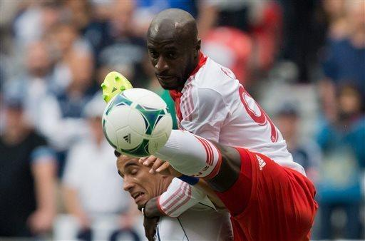 Portland Timbers' Mamadou Danso, right, of Gambia, and Vancouver Whitecaps' Camilo Sanvezzo, of Brazil, vie for the ball during the first half of an MLS soccer game in Vancouver, British Columbia on Saturday, May 18, 2013. (AP Photo/ The Canadian Press, Darryl Dyck)