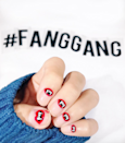 """Consider this interpretation way cooler than the cheap plastic fangs at the Halloween store. Make like nail artist Hang Nguyen with <a href=""""https://www.amazon.com/OPI-Nail-Lacquer-Coca-Cola-Red/dp/B000NG90NE"""" rel=""""nofollow noopener"""" target=""""_blank"""" data-ylk=""""slk:OPI's Coca Cola Red"""" class=""""link rapid-noclick-resp"""">OPI's Coca Cola Red</a>, <a href=""""https://www.amazon.com/OPI-Nail-Lacquer-Black-Onyx/dp/B000NG4778"""" rel=""""nofollow noopener"""" target=""""_blank"""" data-ylk=""""slk:Black Onyx"""" class=""""link rapid-noclick-resp"""">Black Onyx</a>, and <a href=""""https://www.amazon.com/OPI-Nail-Lacquer-Alpine-Snow/dp/B002D4DQ1Q"""" rel=""""nofollow noopener"""" target=""""_blank"""" data-ylk=""""slk:Alpine Snow"""" class=""""link rapid-noclick-resp"""">Alpine Snow</a>."""