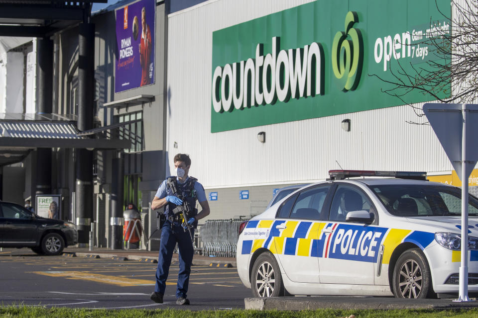 Armed police stand outside a supermarket in Auckland, New Zealand on September 4, 2021. Source: AP/Brett Phibbs