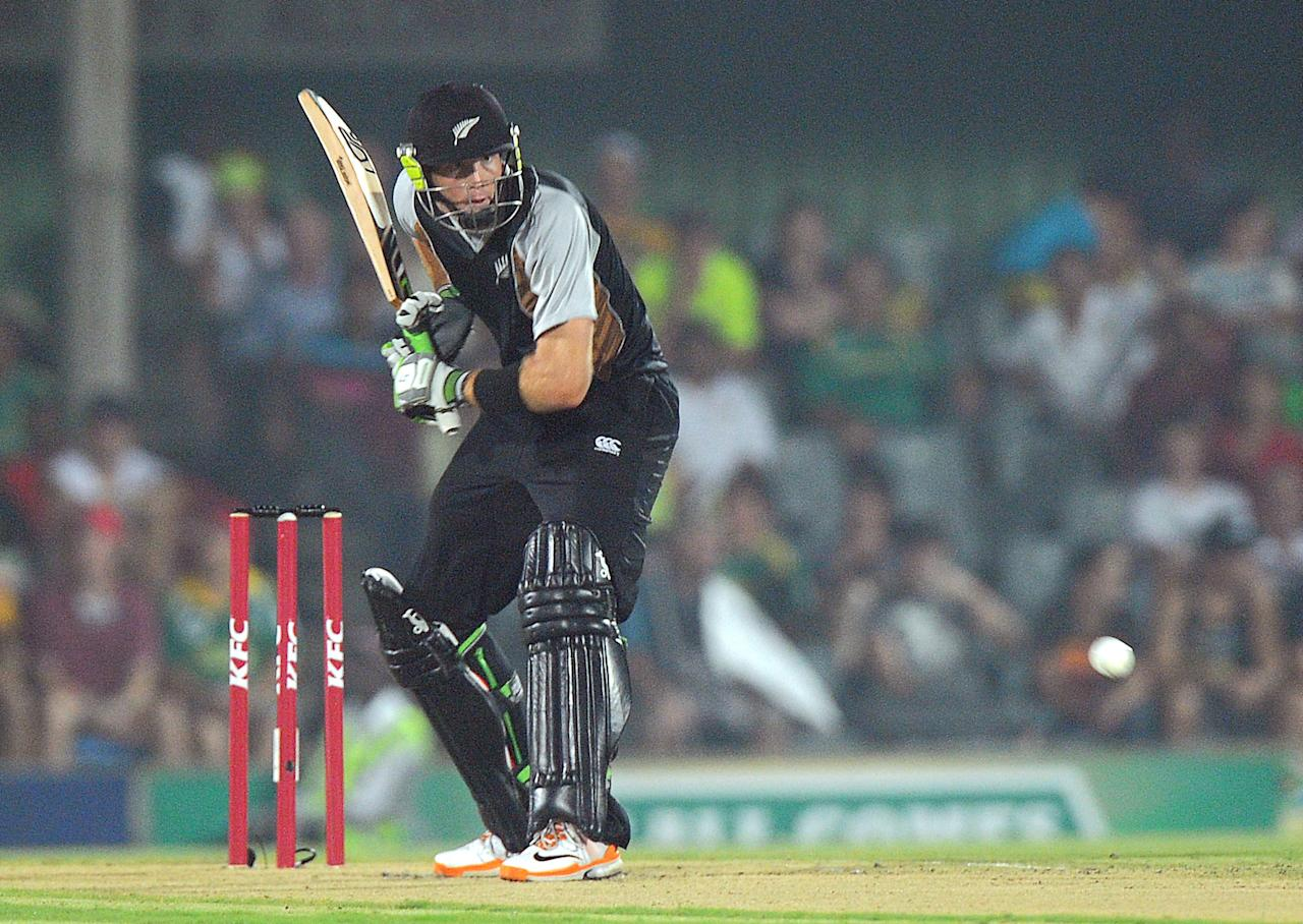 New Zealand batsman Martin Guptill lines up a shot thrown by South African bowler Rory Kleinveldt (unseen), in East London at Buffalo Park on December 23, 2012, during the 2nd T20 match between South Africa and New Zealand. New Zealand won the Toss and chose to field.  AFP PHOTO / ALEXANDER JOE