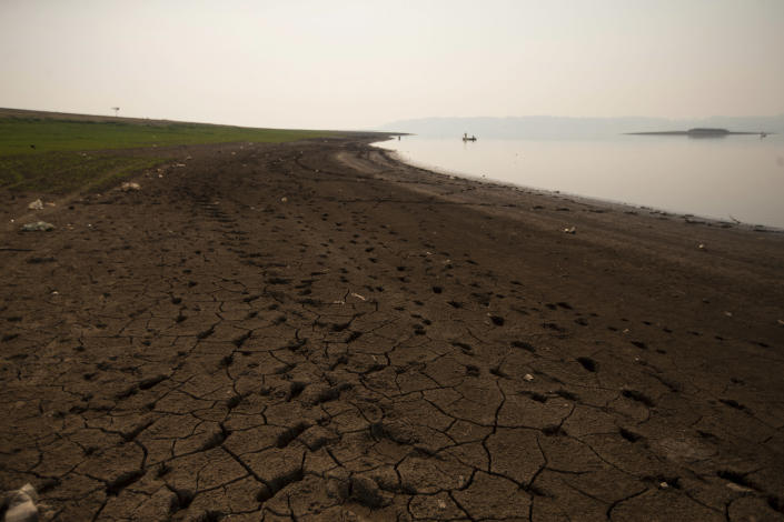 Cracked earth lines the banks of the Villa Victoria Dam, the main water supply for Mexico City residents, on the outskirts of Toluca, Mexico, Thursday, April 22, 2021. The mayor of Mexico City said Mexico's drought was the worst in 30 years. (AP Photo/Fernando Llano)