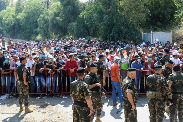 Lebanese security forces deploy in strength as thousands of Syrians, overwhelmingly supporters of veteran incumbent Bashar Assad, queue to cast early ballots for next week's presidential election