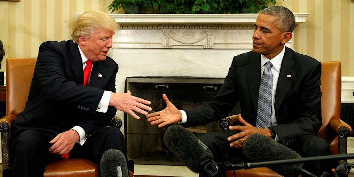 FILE PHOTO: U.S. President Barack Obama meets with President-elect Donald Trump in the Oval Office of the White House in Washington November 10, 2016. REUTERS/Kevin Lamarque