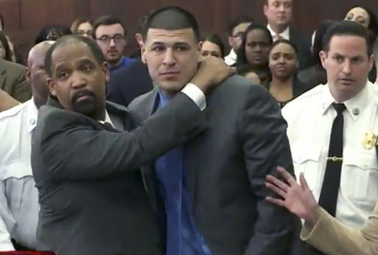 Aaron Hernandez is hugged by defense attorney Ronald Sullivan after being found not guilty of murder. (AP)