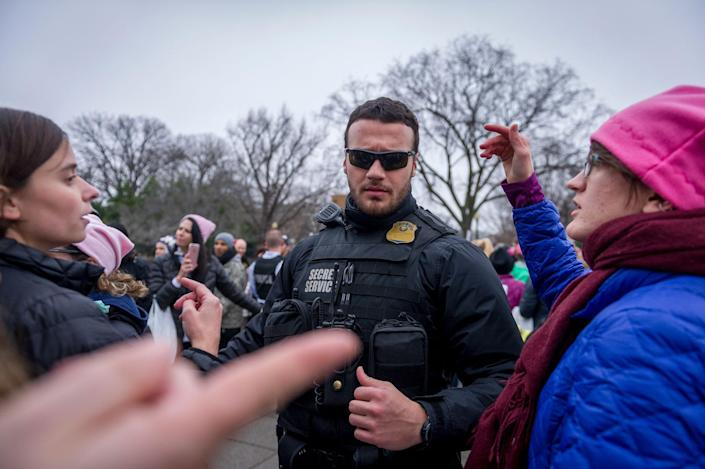 <p>Near the White House, US Secret Service officers worked to move demonstrators out of the area. Thousands of demonstrators gather in the Nation's Capital for the Women's March on Washington to protest the policies of President Donald Trump. January 21, 2017. (Photo: Mary F. Calvert for Yahoo News) </p>
